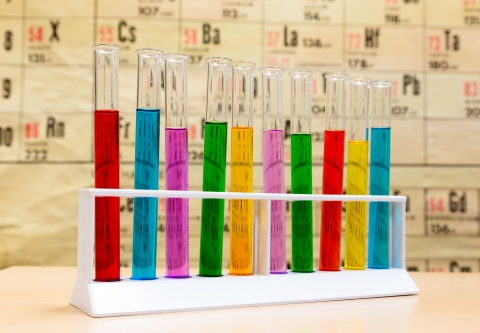 Test tubes, table of elements. Photo credit: Ben Schonewille / Shutterstock